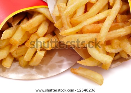 Close-up view to french fries. Shallow depth of field. Not isolated, shot in studio on white.