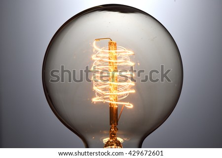 Close up vintage glowing light bulb - stock photo