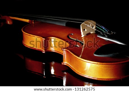 Close-up violin on black background - stock photo