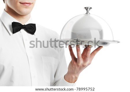 Close up waiter hand with tray and metal cloche lid cover - stock photo