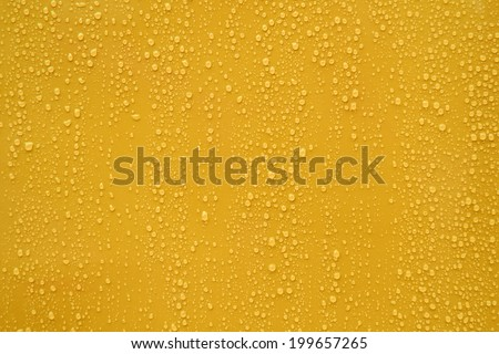 Close up water drop on orange background. - stock photo
