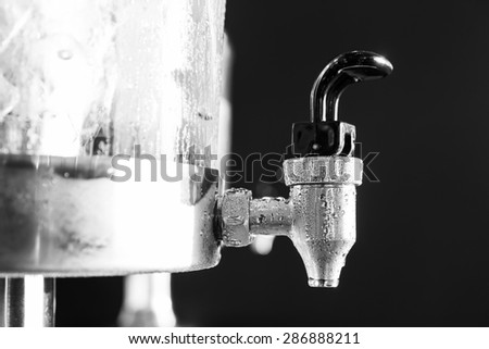 Close up water droplet on stainless steel cooler valve - stock photo