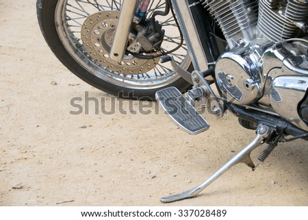 Close up Wheel and Stand motorcycle chopper on the floor. - stock photo