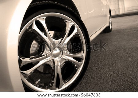 Close up wheel of a spots car - stock photo