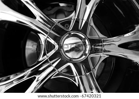 Close up wheel of a spots car - stock photo