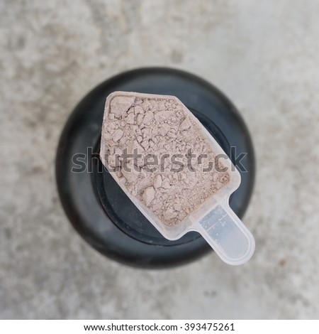 close up Whey protein scoop - stock photo