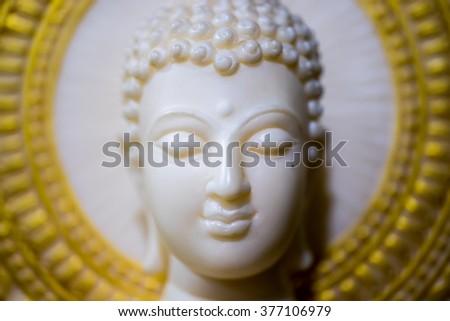 Close up White buddha statue head - stock photo