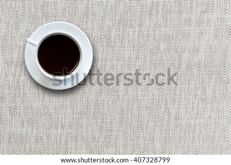 Close up white coffee cup on fabric background top view - stock photo