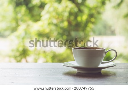 Close up white coffee cup on the table at morning time
