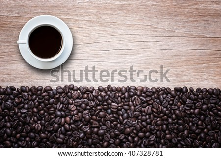 Close up white coffee cup on wooden table top view - stock photo
