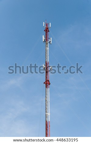 Close up white color antenna repeater tower on blue sky, selective focus and soft focus - stock photo