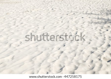 close up white cream sand beach background.grain of sand texture perspective view:summer season beach tropical wallpaper:nature natural:hot sunny day:holiday vacation:clean ecology environment:image - stock photo