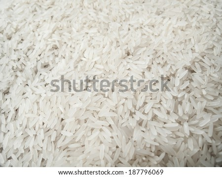 Close up white long raw rice background - stock photo