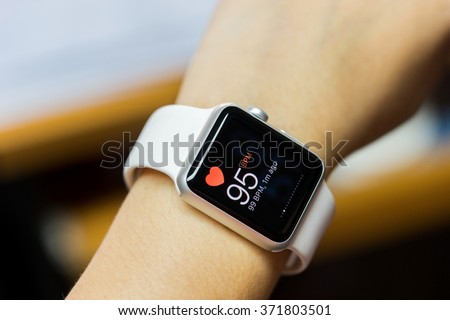 Close up white smart watch with health app icon on the screen - stock photo