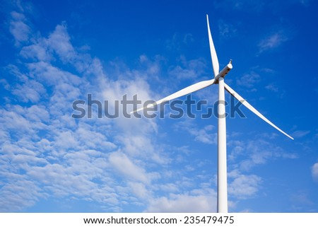 Close up Wind turbine electric generator on blue sky and white cloud - stock photo