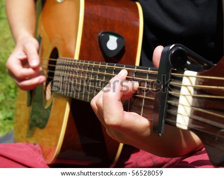 close up with guitar played outdoor