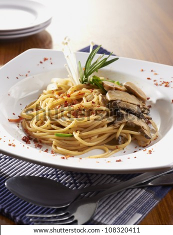 close-up with mushroom pasta on table - stock photo