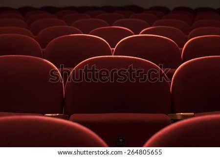 Close up with red seats in theater hall