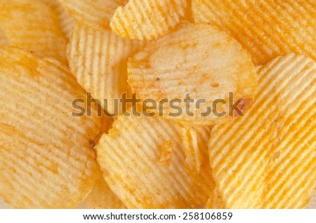 Close-up with tasty traditional potato chips snacks