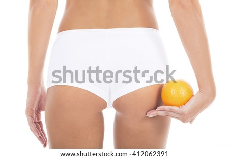 Close up woman backside with orange in hand, isolated on white background, Focus is located on the hand with the orange fruit.  - stock photo