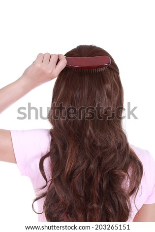 close-up woman brushing her hair isolated on white background - stock photo