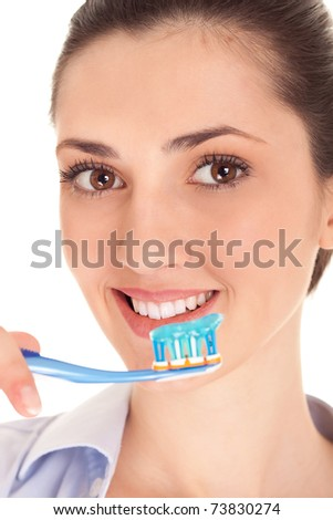 close-up,  woman brushing her teeth with toothpaste and a manual toothbrush, isolated on white - stock photo