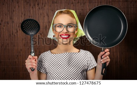 Close-up woman cook with pan and spoon - vintage concept - stock photo