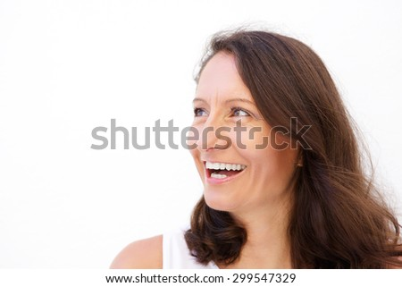 Close up woman face laughing against white background - stock photo