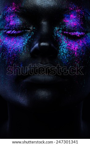 Close up  woman face with neon make up - stock photo