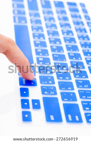 Close up woman finger on alternate button blue Thai keyboard cover - stock photo