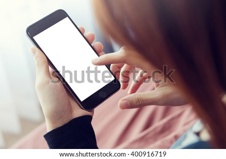 Close up Woman hand Using a Smart Phone on  bed at home. - stock photo