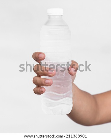 Close up Woman holding bottle of drinking water - stock photo