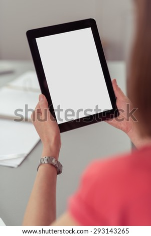 Close up Woman Holding Portable Tablet Computer with White Blank Screen, Emphasizing Copy Space. - stock photo