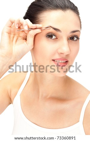 close up, woman looking in mirror and plucking eyebrows, isolated on white - stock photo