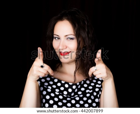 Close-up woman looks straight into the camera on a black background. shows various signs hands. expresses different emotions - stock photo