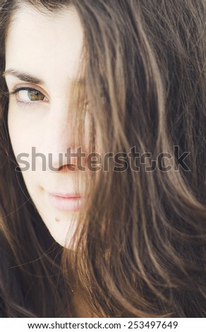 Close up woman portrait with dark hair - stock photo