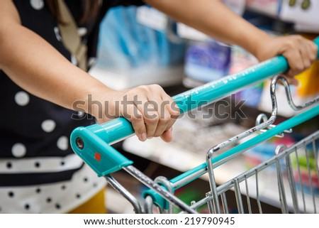 Close up woman shopping in department store - stock photo