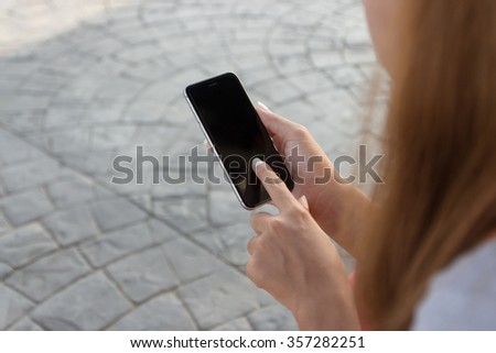 close up woman touch on phone modern lifestyle in city - stock photo