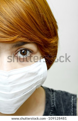 close-up woman wearing protective mask.