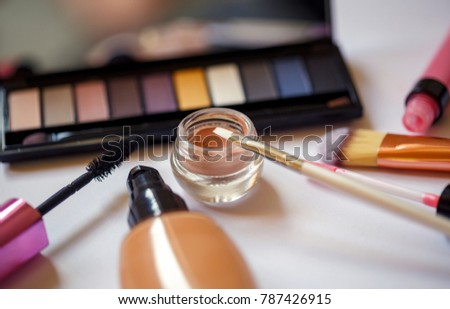 close up women's cosmetics set on background of white
