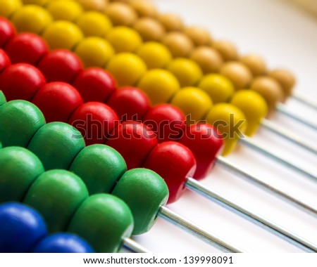 Close up wooden abacus with selective focus - stock photo