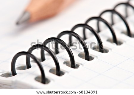 Close up wooden pencil on ring bound pad - stock photo