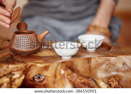 Close-up wooden table for the tea ceremony utensils on tea master background at home - stock photo