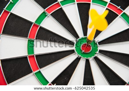 Close up yellow dart on target