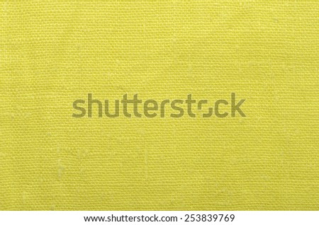 close up yellow linen cloth background - stock photo