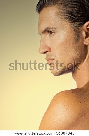 Close-up young and sexy brunet male face - stock photo