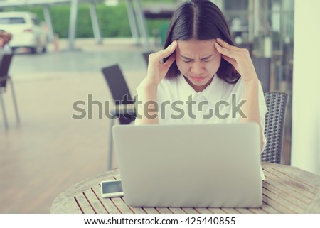close up young asian woman stress with work job:employee hand gesture palm up over face/head:upset/sad symptom concept:depression:migraine effect.perspective view.headaches pain:severe risk of health - stock photo