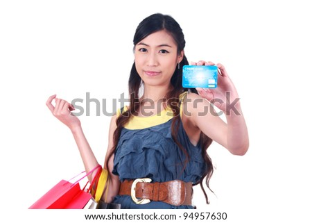Close up Young asian woman  with a credit card and shopping bags on white - stock photo