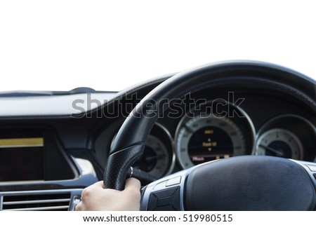 Close up young beautiful woman driving a luxury car on white background.