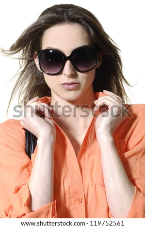 Close up young beautiful woman with long hair. in sunglasses - stock photo